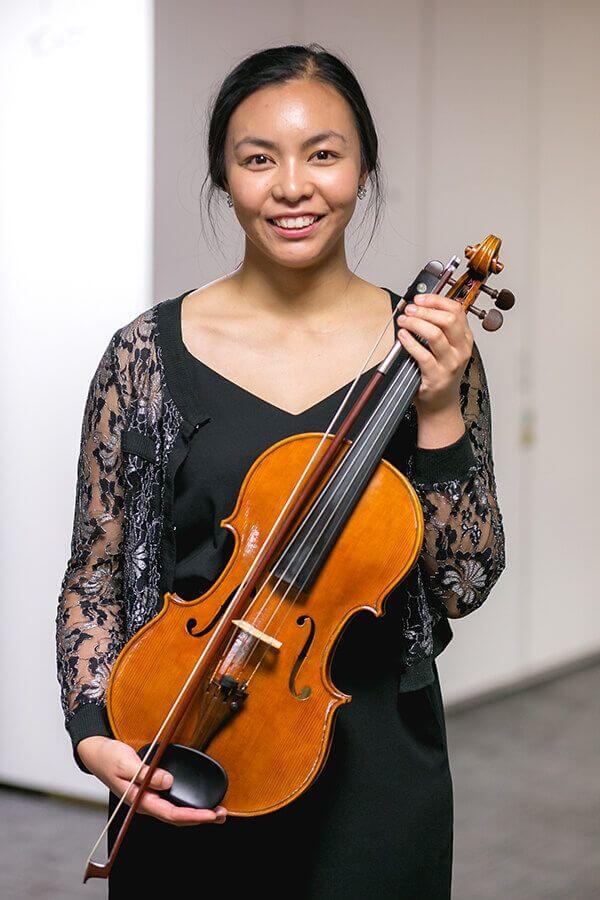MUSICAL CHAIRS_ The Administrators Orchestra: Jin Tong Long. Image Credit Jared Enano