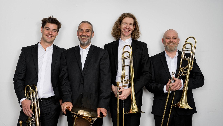 Overland Ensemble musicians, L to R: Mitchell Nissen (bass trombone); Tim Jones (tuba); Iain Faragher (trombone) and David Robins (trombone).